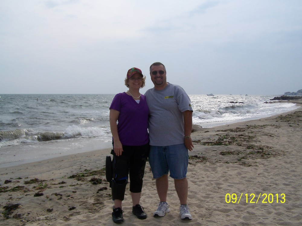 Sharon and her husband Sal enjoying a walk on the beach