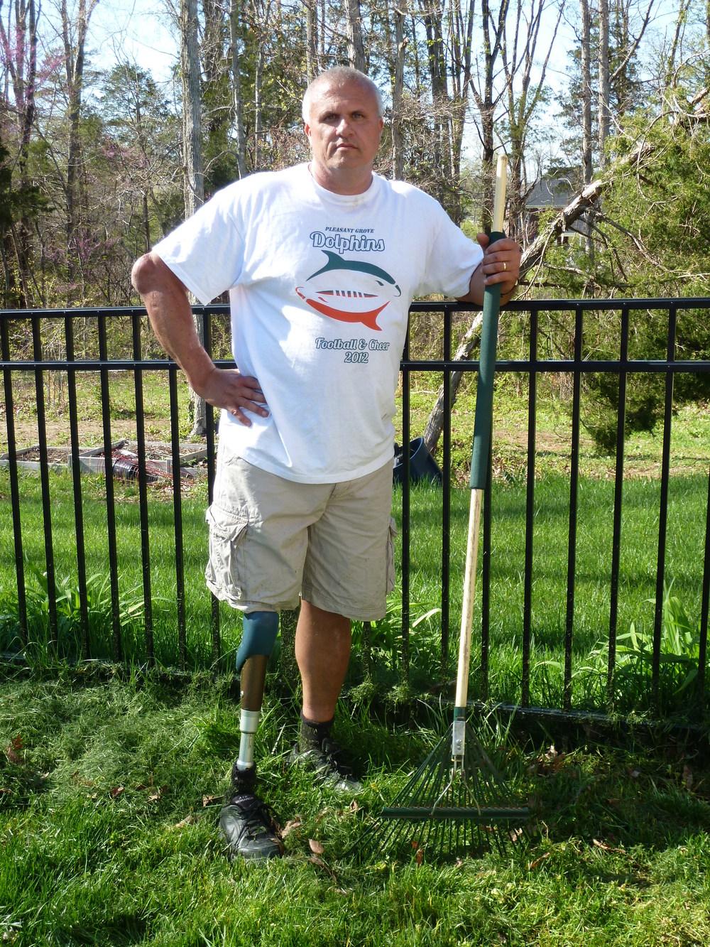 Kevin raking his yard
